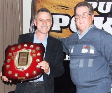 Phill King (left) receives the Lindsay Jones Trophy from our Club founder, Ray Storey.