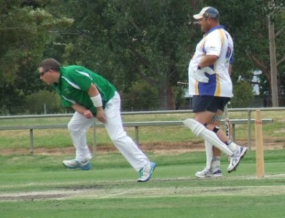 Captain Daniel Phillips bowls in Game 2.