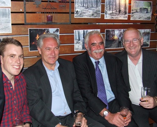 L-R: Nigel Walker, his big boss Rod Wilson, Charlie Walker and Jim Tennison swap stories at the fundraiser.