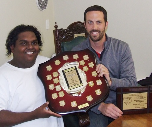 Michael Ozbun (right) receives his Lindsay Jones Best Clubman trophy from the previous season's winner, Channa DeSilva.