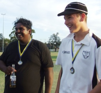 Our young guns: And don't they love it! Channa DeSilva and Jack Newman with their Premiership medals.