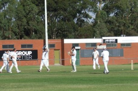 The Moment! The Final Wicket! The West Coburg bat is left mid-pitch with one of the stumps out of the ground. Peter and bowler Sean 0'Kane run in at left to keeper Paul Hobbs, while Dean Lawson and Paul Edwards move in.