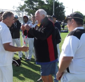 Dean Jukic gets his premiership medal from Ralph Barron, as our captain Mark Gauci looks on.