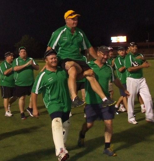 Chaired off after the win, and with a wicket in his last over. Sean O'Kane with his brothers Peter (left) and Mark.
