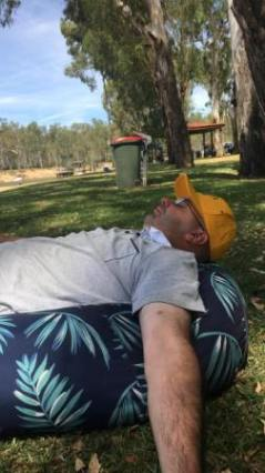 All too much after a hard day at the cricket: Michael Cumbo asleep at Thompson's Beach on the Murray.