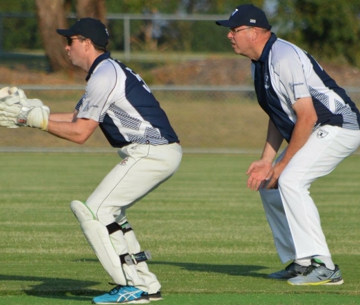 The Moonee Valley Cricket Club emblem is clearly visible on the left hip of Chief Commissioner of Police Graham Ashton, fielding at slip.