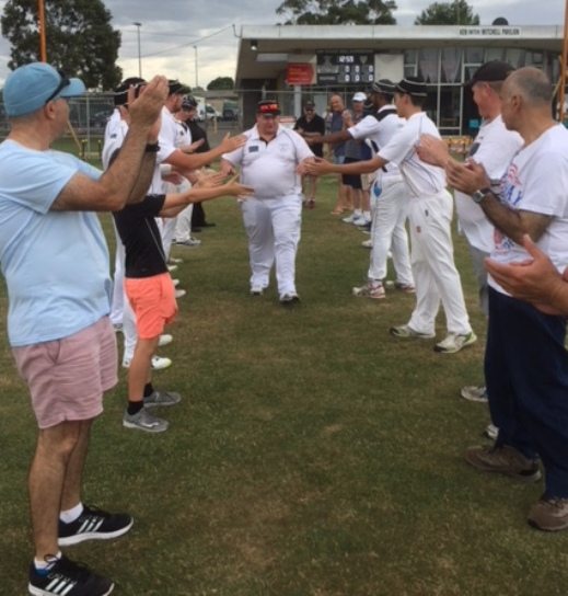 Mark Gauci gets a guard of honor as he makes his way onto Ormond Park for his 300th game, including fellow 300-gamers John Talone (front left) and Joe Ansaldo (front right).