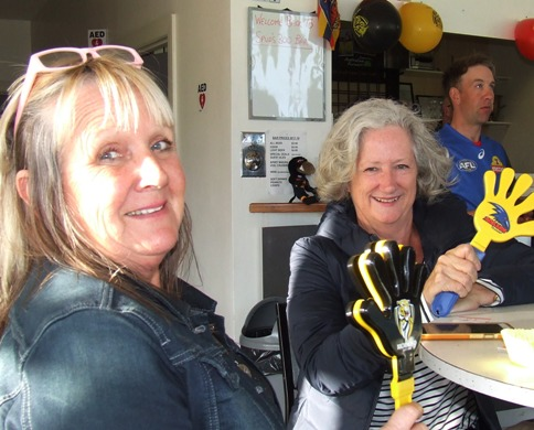 Who are you barracking for? Cricket mums and past players Adele Walker (left) and Vicki Ayers show some true colors.