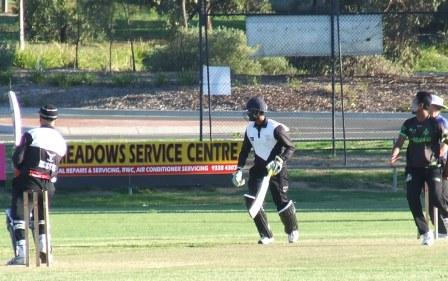 Lou Raffaele dispatches a ball to the boundary, watched by batting partner Chanaka Silva.