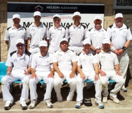 Our Seconds team - in Nelson Alexander caps, and in front of the company's sponsor board at our Ormond Park clubrooms.