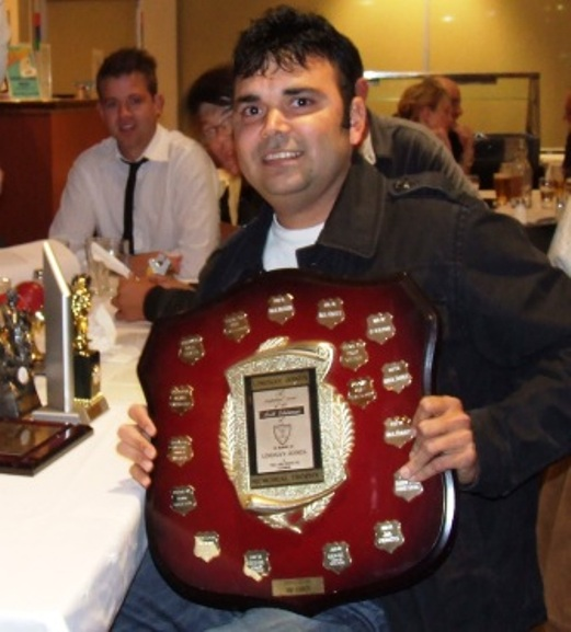 Club Champion Amit Chaudhary with his Lindsay Jones Best Clubman award and some of his other trophies.