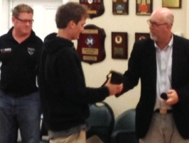 Mitchell Evans receives his Junior Club Champion award from junior co-ordinator Kevin Gardiner, watched by Under 16 coach Simon Thornton.