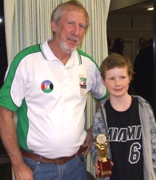 Club legend Doug McLaggan with Dillon Barrett, who won the Doug McLaggan Trophy as the Under 10 White team's best all-rounder.